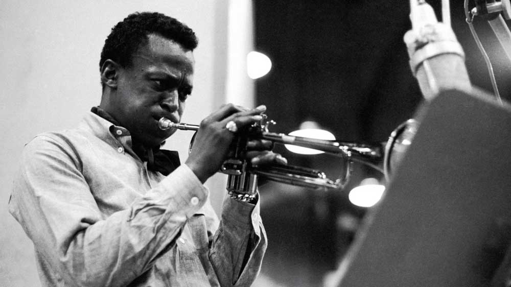 miles-davis-in-one-of-his-trademark-ocbd